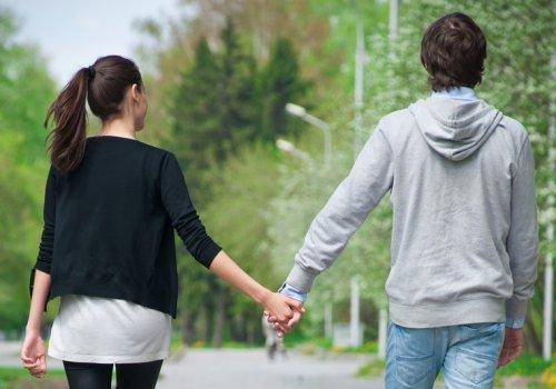 couple walking on road