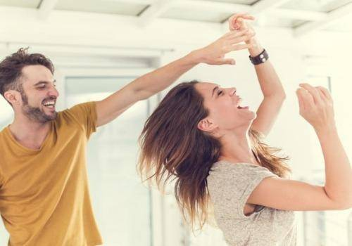 couple dancing in home