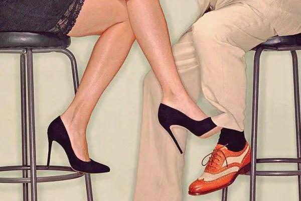 woman legs touching man's leg