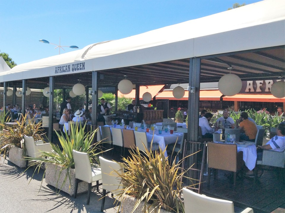 African Queen restaurant terrace in the port of Beaulieu-sur-Mer