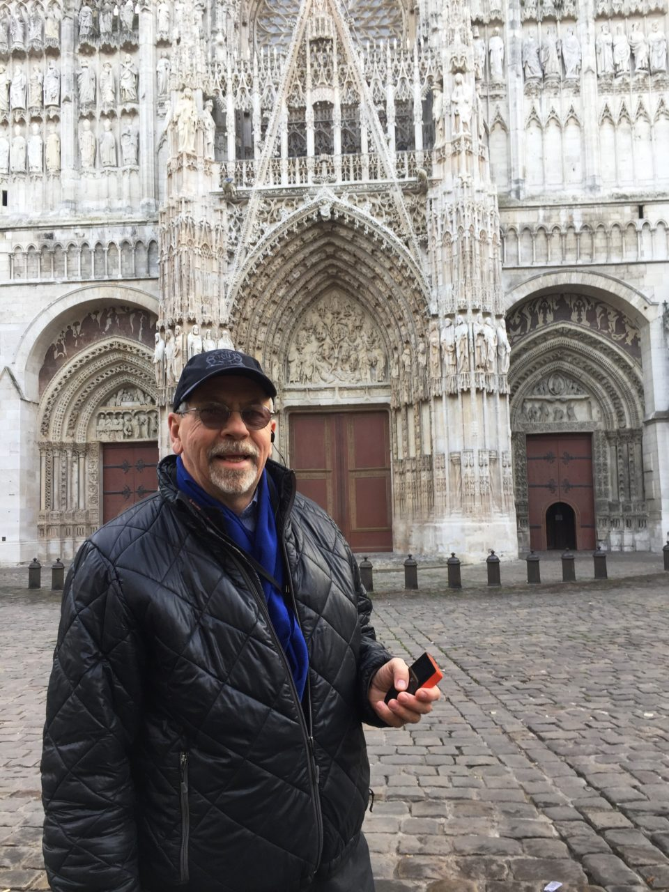 At Rouen Cathedral with my Skyroam global hotspot during our Spectacular Paris and Normandie AmaWaterways Cruise