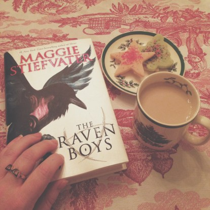 a bookish sinister kid book and a beverage