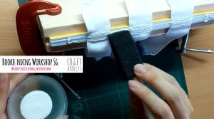 casebinding-apply glue over book spine