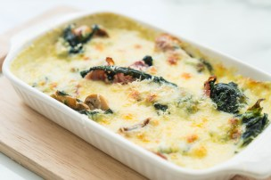 spinach lasagna in white plate - Italian food style
