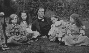 English mathematician, writer and photographer Charles Lutwidge Dodgson, better known as Lewis Carroll (1832 - 1898) with Mrs George Macdonald and four children relaxing in a garden. (Photo by Lewis Carroll/Getty Images)