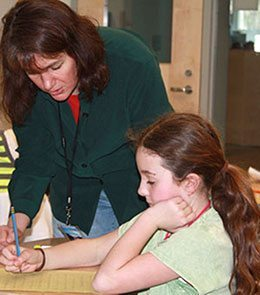 Melissa Stewart working with a student
