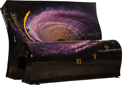 A bench showing an artistic impression of a wormhole with scientific and chronological notation