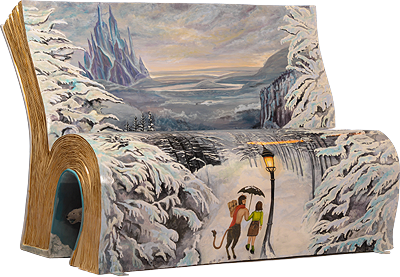 A bench painted with an early scene from C S Lewis's The Lion, The Witch and The Wardrobe
