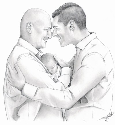 Fathers touching foreheads embracing newborn