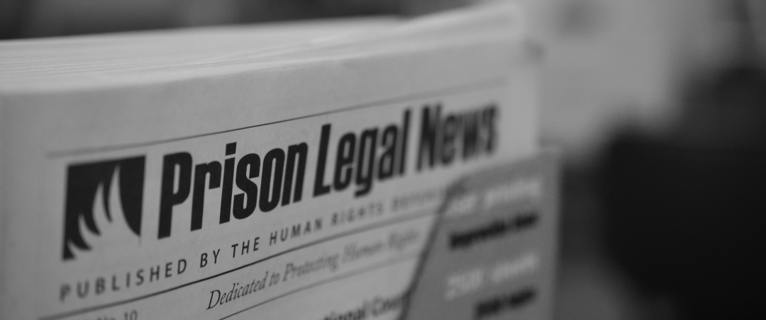 "closeup of a newspaper reading ""Prison Legal News"""