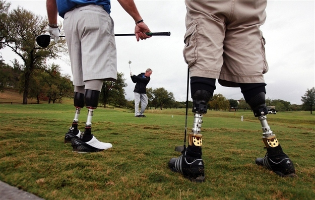 President Bush golfs with wounded veterans at the Warrior Open tournament.
