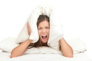 overwhelmed person with pillow over her head