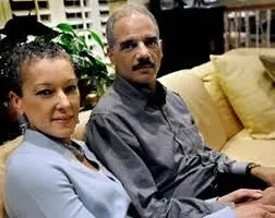Eric Holder and his wife