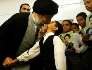 Old Afghan man kisses boy on mouth