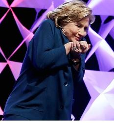 Hillary rubbing hands together