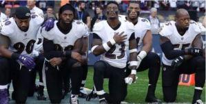 NFL players take a knee
