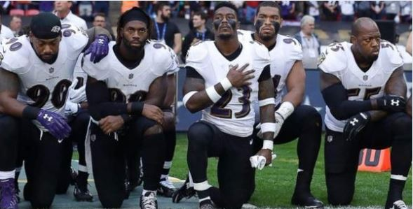 NFL players take a knee