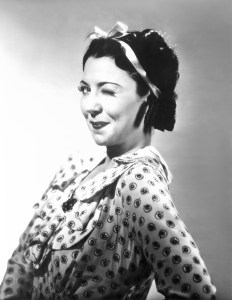 Vintage photo of woman winking at the camera