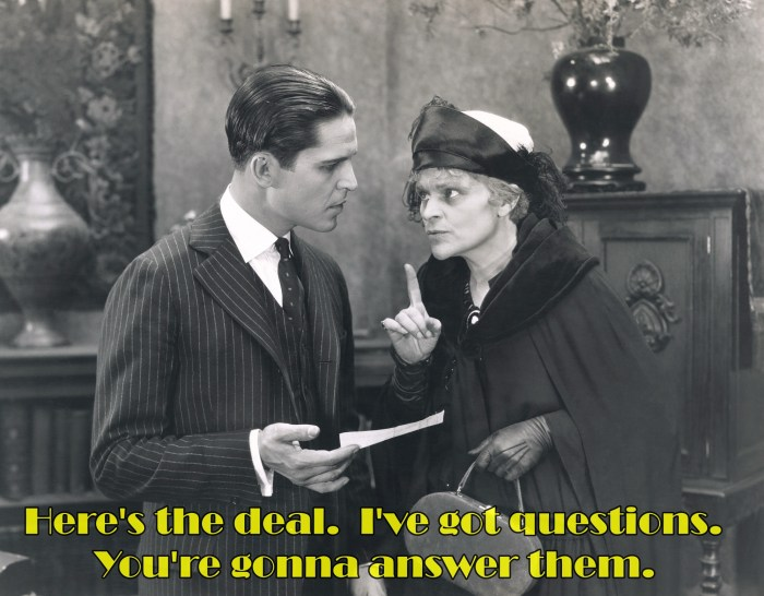 Black and white vintage picture of a stern older woman wagging her finger at a younger man in a suit about continuing care retirement communities.