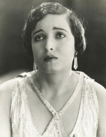 Black and white retro picture of a woman looking unhappy as she dreads the discomfort of deliberate purposeful practice.