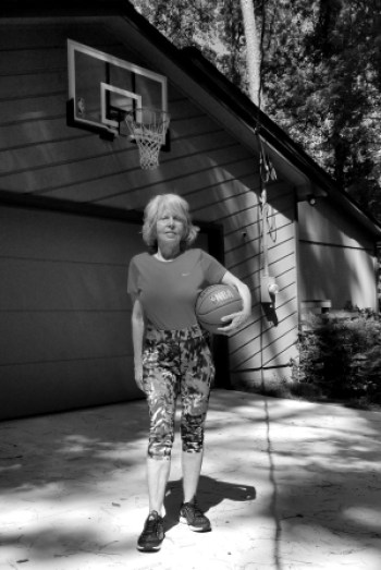 Black and white photo of author holding a basketball before some deliberate and purposeful practice.