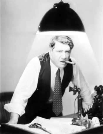 man standing under hanging desk light with cigar in mouth demanding options to lose his bad annuity.