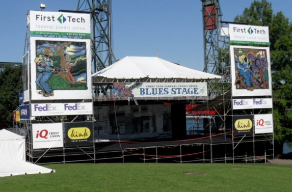 The stage is empty, the grass waiting for the crowds. The blues are on the way.
