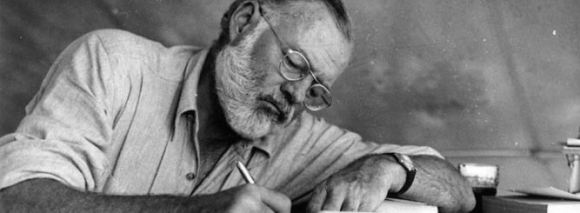 © Hemingway Collection, John F. Kennedy Presidential Library  | Hemingway pictured at his desk. via http://www.wine-searcher.com/m/2012/09/a-farewell-to-arms-a-hello-to-alcohol