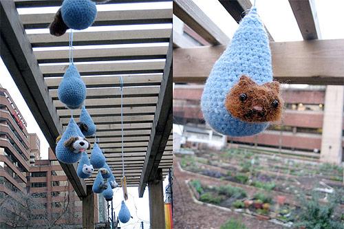 yarnbombing knit graffiti howie woo woowork vancouver davie village community garden street art raining cats and dogs