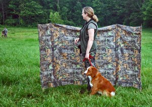 """Biologist Claire Wade and her Toller """"Burn"""" during an NSDTRC-USA Field Test."""