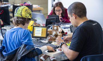 Superhero Boost kid Ryder works on coding a Google DIY kit