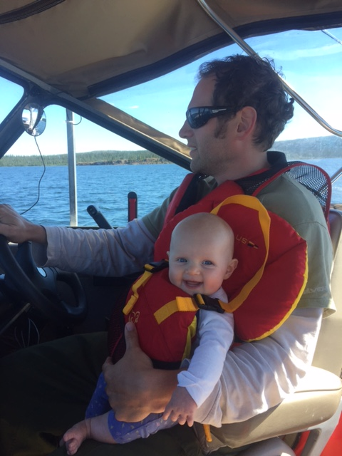 driving the boat with baby