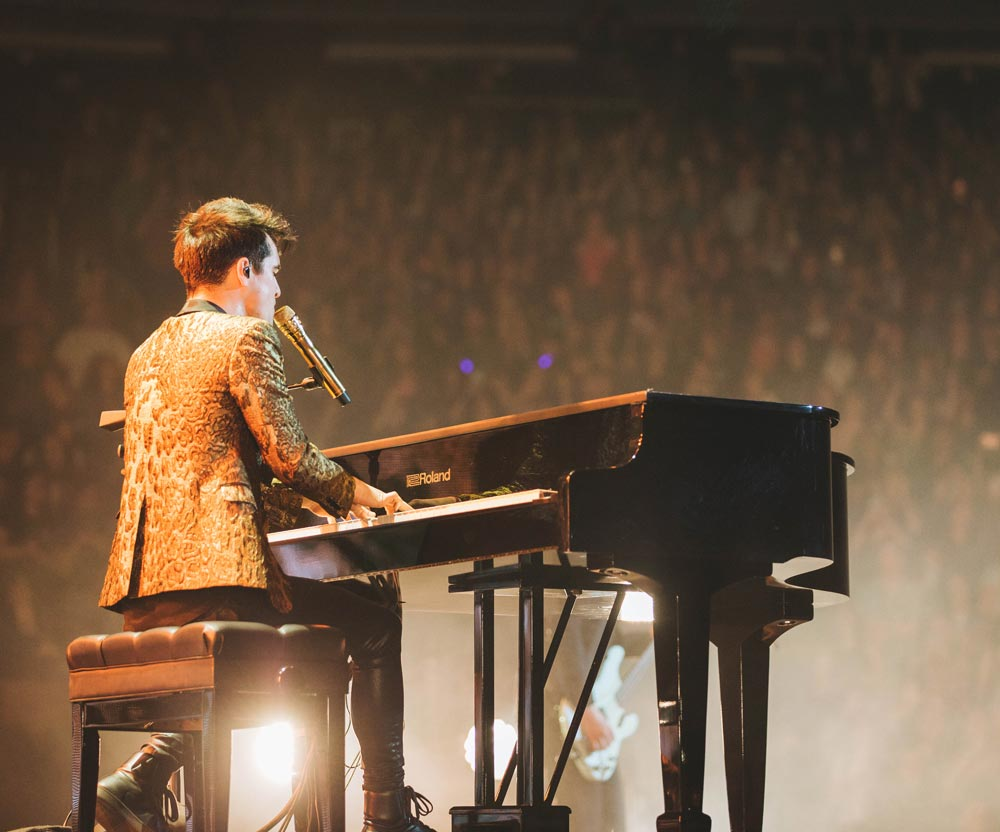 Throughout the Death of a Bachelor arena tour, frontman Brendon Urie performed on two Roland FP-90 Digital Pianos housed in acoustic grand piano shells.