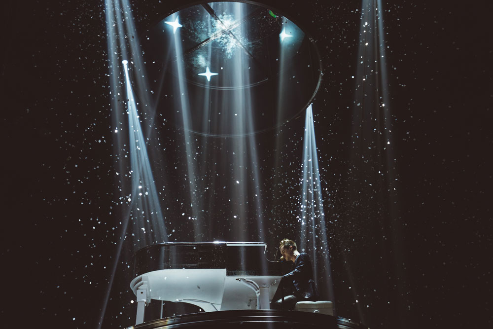 Panic! at the Disco's Brendon Urie performs on a Roland FP-90 Digital Piano housed in an acoustic grand piano shell.