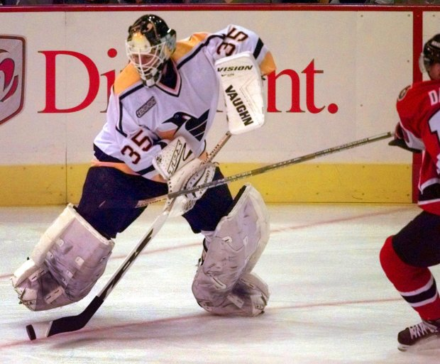 Tom Barrasso handles the puck during a 1999 game with the Pittsburgh Penguins. The Acton-Boxboro legend never scored a goal, but does hold the NHL's record for career assists by a goalie with 48.