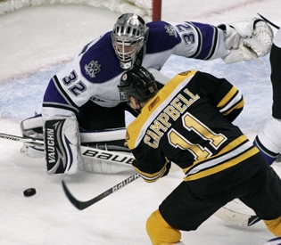 Jonathan Quick makes a save on former Bruins forward Gregory Campbell. The Los Angeles Kings' Conn Smythe winner scored a goal for UMass in 2007, and also as a minor leaguer later that year.