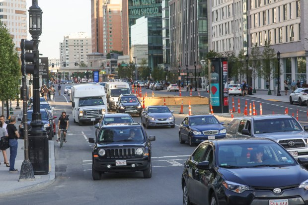 Traffic leaves the Seaport area in Boston