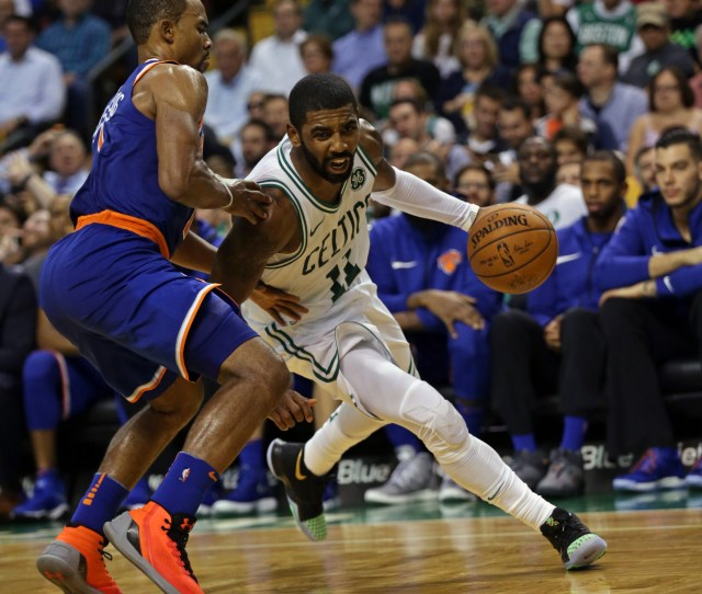 Boston Ma   Kyrie Irving Drives Past  Ramon Sessions In The Third Quarter Of The Boston Celtics Vs New York Nicks Game At The Td Garden