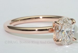 Oval diamond set in 18k rose gold solitaire engagement ring