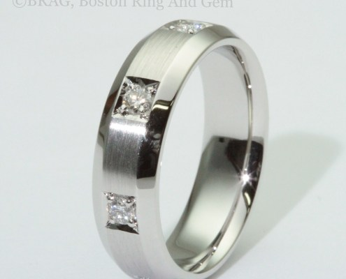 Platinum and diamond inset bevel edge men's wedding ring