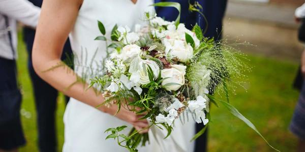 Bride holding bouquet of wedding flowers. Photo by Mad Lilies