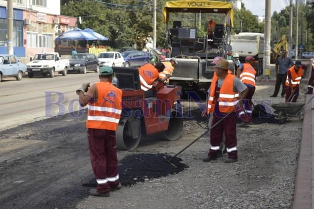 muncitori turnat asfalt strada primaverii botosani