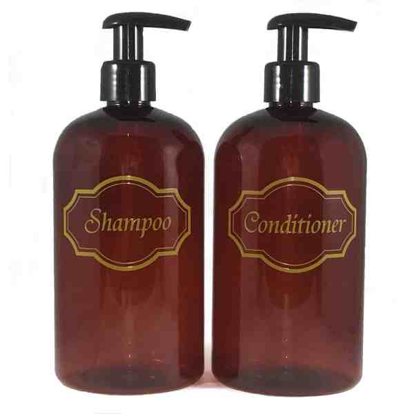 Amber shampoo and conditioner bottles with black pumps and gold print