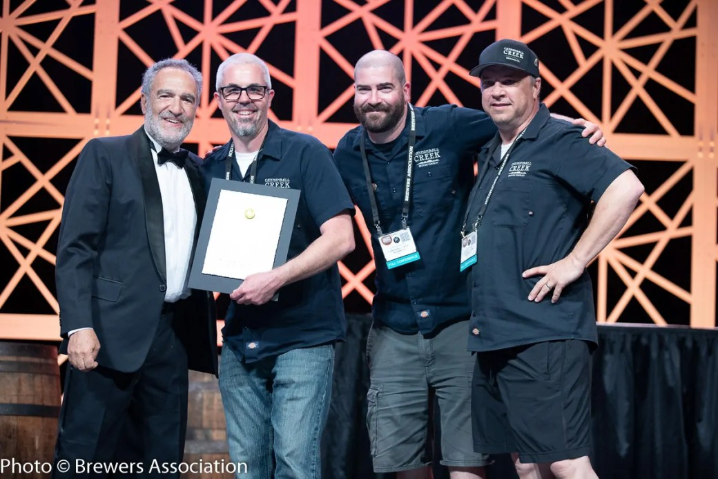 Cannonball Creek Brewing Co accepting gold for Trump Hands, their Session IPA, at the 2018 World Beer Cup