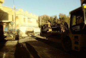 تزفيت شارع شعبة بن عدل بعد تركيب قنوات صرف مياه .. في صور