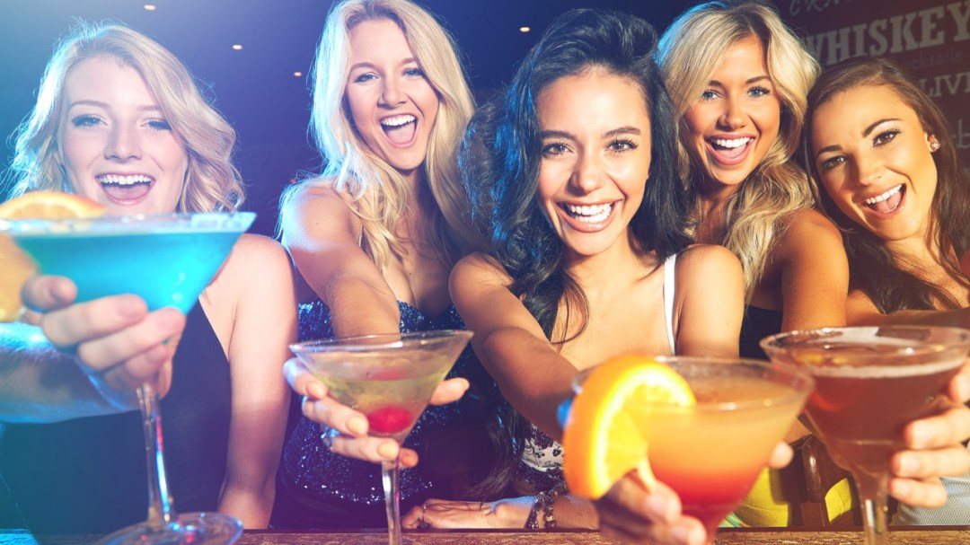 a group of girls having fun showing off their drinks