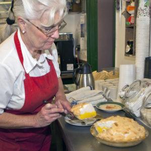 Virginia Smoot cuts a slice of her traditional lemon meringue pie at the Corner Café in Colorado Springs.