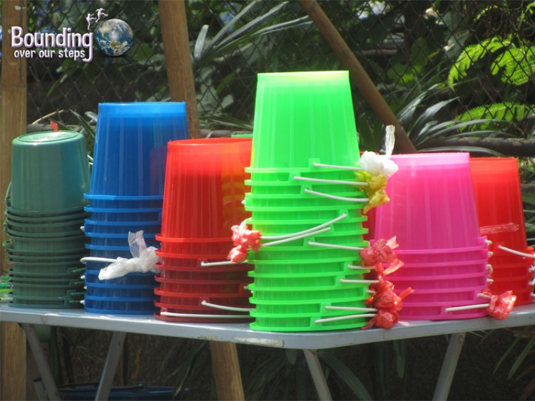 A row of colorful buckets for sale during Songkran in Chiang Mai, Thailand