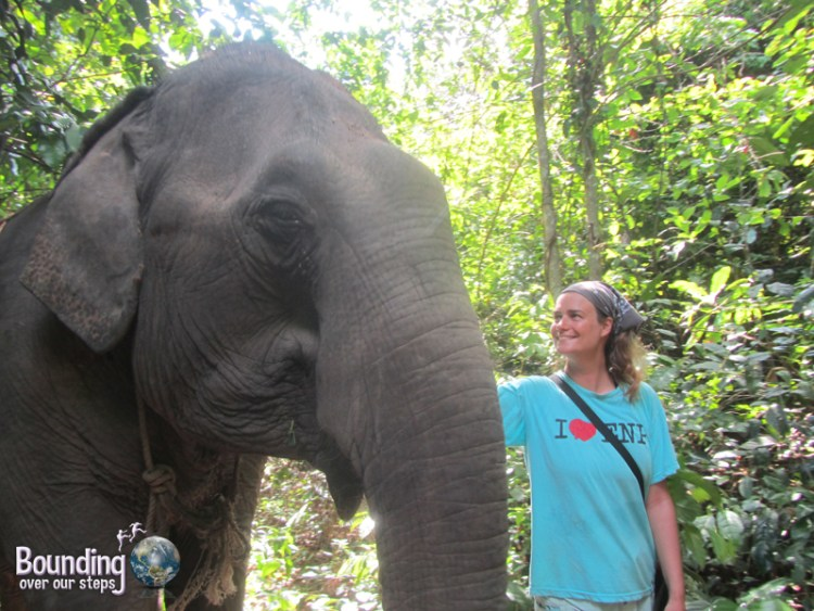 Ligeia walking beside Kham Lin on the jungle path during the elephant walk
