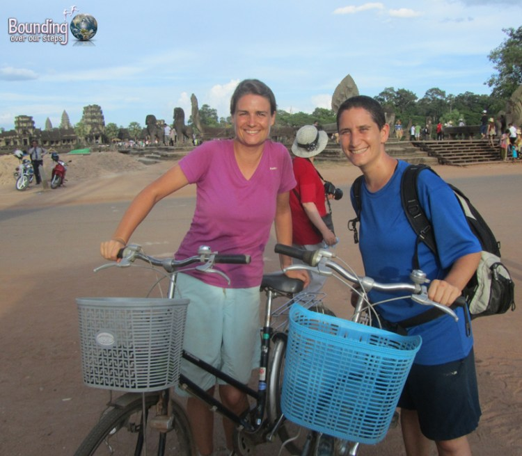 Ligeia and Mindy with our rickety, rented bicycles in front of Angkor Wat